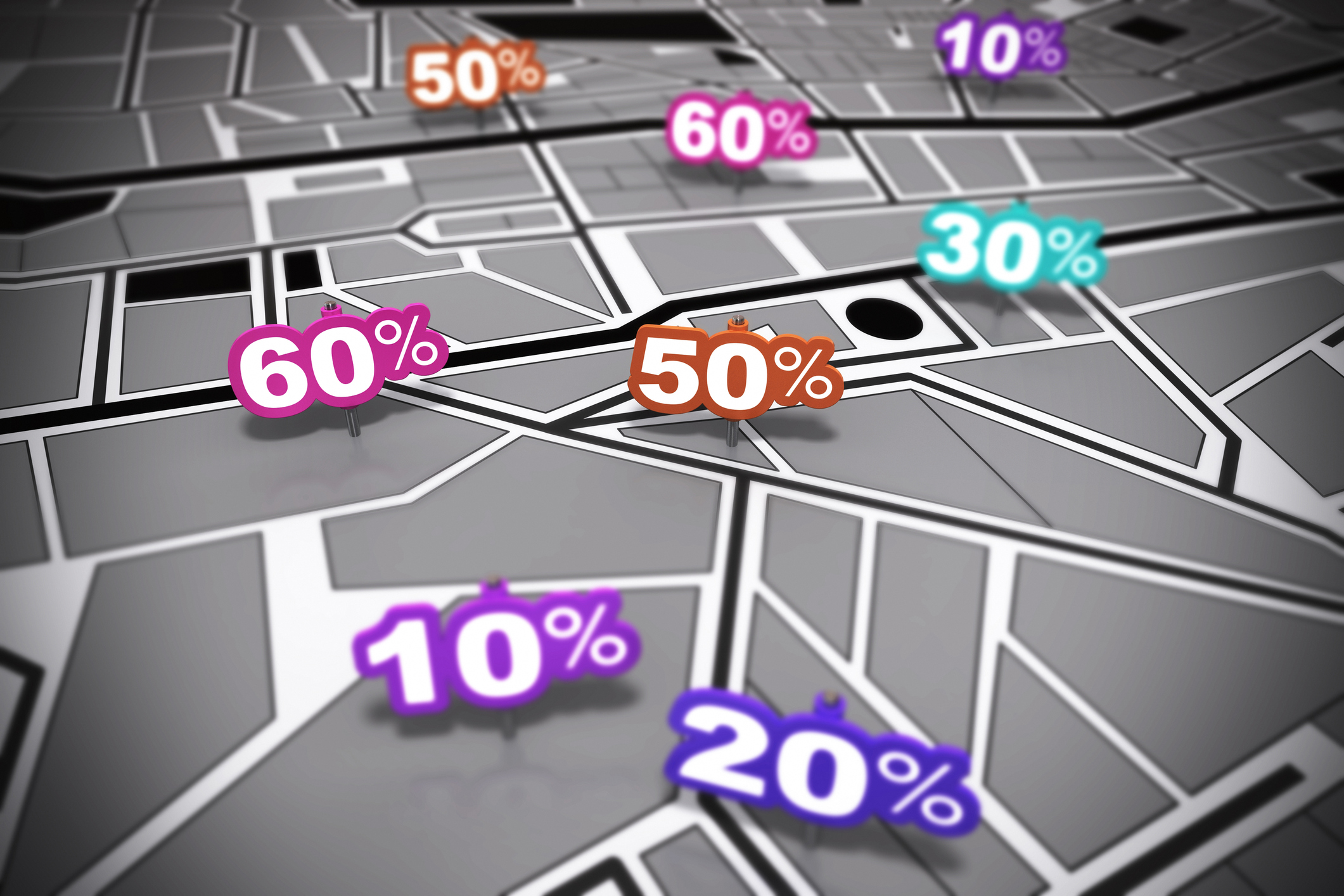 many percent signs over a grey city map with focus effect each number is pointing onto a different location